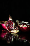 Opened pomegranate in black background Stock Photo