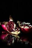 Opened pomegranate in black background Stock Photo
