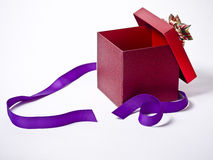 Opened Present With Purple Ribbon Royalty Free Stock Photography