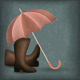Opened rain umbrella and rubber boots Stock Image