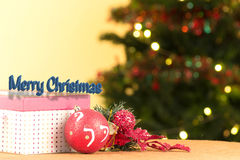 Opened red Christmas gift box with ornaments Stock Photos