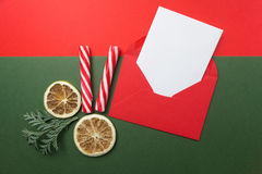 Opened red envelope with blank paper sheet included. Top view. Flat lay. Stock Image