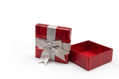 Opened red gift box. An opened red gift box with white ribbon, for any occasion Stock Photography