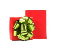 Opened red gift box with green-golden bow. Royalty Free Stock Image