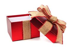 Opened red gift box with rustic burlap bow and ribbon Royalty Free Stock Images