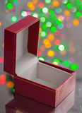 Opened red gift box on surface of miror Royalty Free Stock Photo
