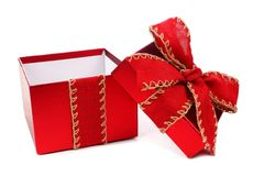 Opened white Christmas gift box with red bow and ribbon isolated Royalty Free Stock Images