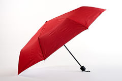 Opened red umbrella isolated on white background Stock Images
