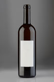 Opened red wine bottle with blank label Royalty Free Stock Photos