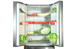 Opened refrigerator. Fresh vegetables in a refrigerator Royalty Free Stock Image