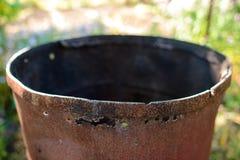 Opened rusty manhole on orange fuel tank Stock Photography