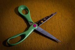Opened scissors. Opened big sharp green scissors Stock Photo