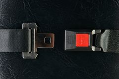 Opened seat belt on black leather background. Close-up. Safety concept Royalty Free Stock Image