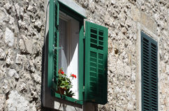 Opened shutters. With sunshine Stock Images