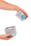 Opened silver gift box with blue ribbon. White background Royalty Free Stock Photos