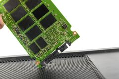 Opened solid state drive closeup. On white background Stock Photography