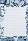 Opened spiral notepad  on money background   stained blue. Royalty Free Stock Photography