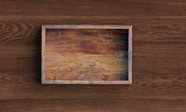 Opened square wooden box on wooden table. 3d rendering royalty free illustration