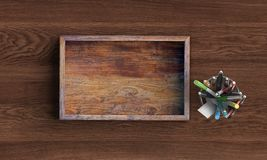 Opened square wooden box on wooden table. 3d rendering stock photography