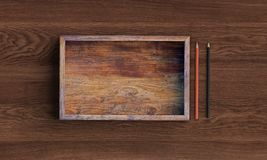 Opened square wooden box on wooden table. 3d rendering stock illustration
