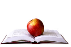 Opened student book with red apple Royalty Free Stock Photos