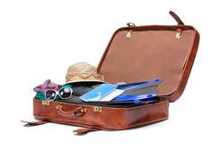 Opened suitcase with clothing for traveling Royalty Free Stock Images