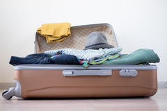 Opened suitcase on floor Royalty Free Stock Photos