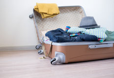 Opened suitcase on floor Royalty Free Stock Image