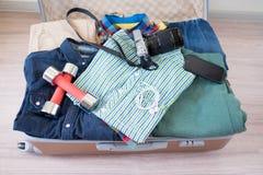 Opened suitcase on floor Stock Photos