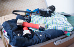 Opened suitcase on floor. Opened large suitcase with clothes and hipster stuff in it on the  floor Stock Images