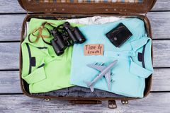 Opened suitcase packed with clothes. Top view, flat lay. Travel attributes Stock Image