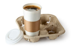 Opened take-out coffee in holder. Standing on a white Royalty Free Stock Images