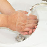 Opened tap water and washing hand Stock Photo