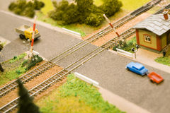 Opened toy railway crossing Royalty Free Stock Image