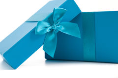 Opened turquoise blue gift box with a bow Royalty Free Stock Images