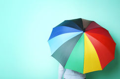 Opened umbrella. Colorful opened umbrella on green background Royalty Free Stock Images