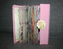 Opened vintage-style small photo album. Handmade by photographer Royalty Free Stock Photos