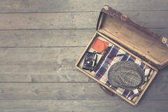 Opened vintage suitcases with clothes and accessories Royalty Free Stock Image
