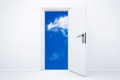 Opened white door with cloudy sky Royalty Free Stock Photo