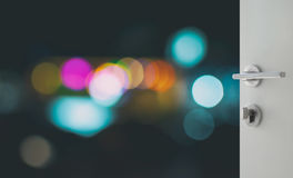 Opened white door to abstract background with bokeh defocused lights and shadow royalty free stock images