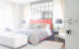 Opened white door to blurred background bedroom in classic style Stock Images