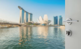 Opened white door to blurred skyline of singapore cityscape Stock Image