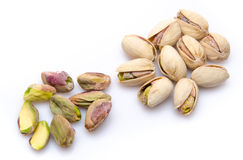 Opened and whole pistachios Stock Photography