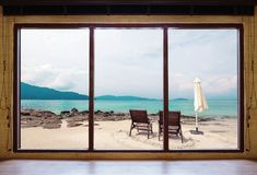 Opened window seeing tropical beach view in summer holiday at weekend house and resort