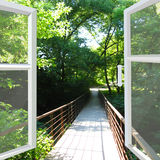 Opened window to the bridge across ravine Stock Images