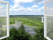 Opened window to the summer landscape Stock Images