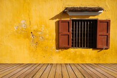 Opened-window on yellow wall and wood floor Royalty Free Stock Photo