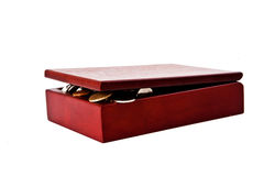 Opened wooden box with coins Royalty Free Stock Photos
