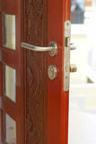 Opened wooden dark red door Stock Photos