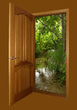 Opened wooden door with forest brown Royalty Free Stock Photo